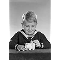 Studio shot of boy inserting coin into piggy bank Poster Print (18 x 24)
