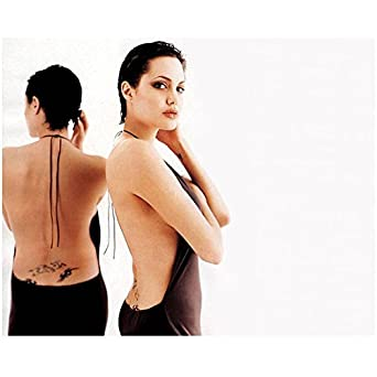 Angelina jolie short hair wearing backless dress head turned arms angelina jolie short hair wearing backless dress head turned arms crossed hand on hair mirror background urmus Image collections