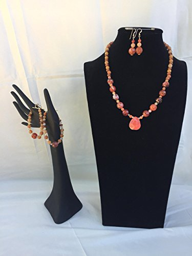 Bold and beautiful handmade jewelry set with a necklace, two bracelets and matching dangle earrings. Vivid coral colored mixed gemstones. One of a kind by The Stonz Project