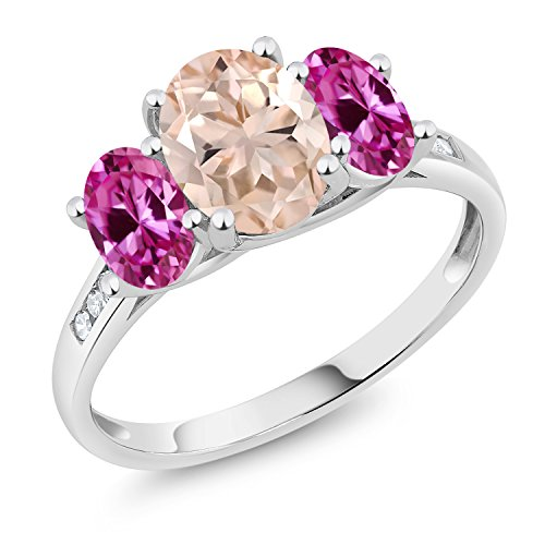 - Gem Stone King 10K White Gold Diamond Accent Oval Peach Morganite Pink Created Sapphire 3-Stone Ring 2.00 Ct (Size 8)