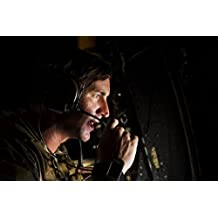 A pararescueman assigned to the 82nd Expeditionary Rescue Squadron communicates over radio in prepar