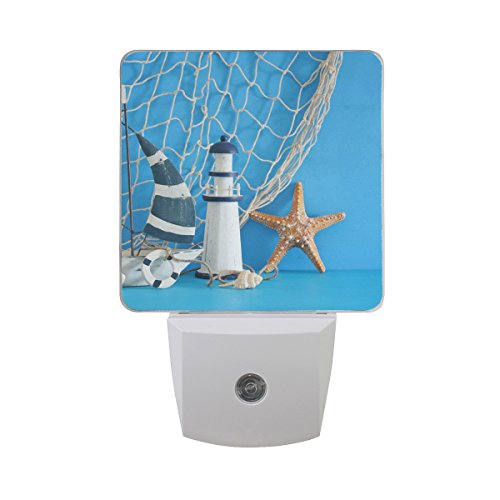 Naanle Set of 2 Nautical Theme Sailboat Lighthouse Starfish Seashells Fishnet Over Blue Wooden Table White Decorative Auto Sensor LED Dusk To Dawn Night Light Plug In Indoor for Adults by Naanle