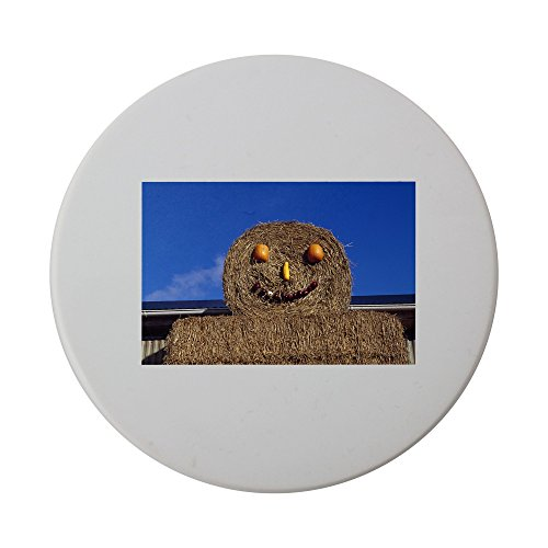 Low angle view of hay bales decorated with vegetables dep...