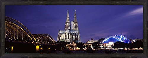 City at dusk, Musical Dome, Cologne Cathedral, Hohenzollern Bridge, Rhine River, Cologne, North Rhine Westphalia, Germany by Panoramic Images Framed Art Print Wall Picture, Espresso Brown Frame, 38 x (Rhine River Framed)