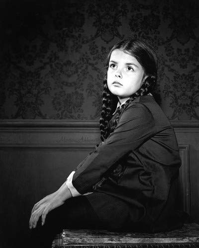 Lisa Loring in The Addams Family sitting on chair as Wednesday 8x10 Aluminum Wall Art