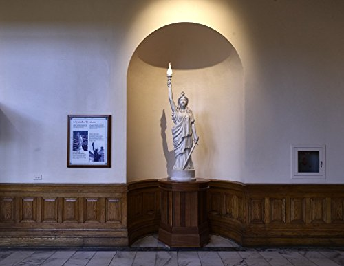 "Photograph | A model of""Miss Freedom,"" the statue that stands high above this space on the dome of the state capitol building in Atlanta