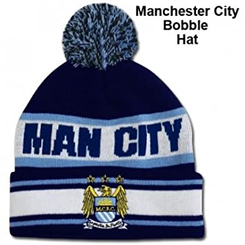 Man City Bobble Hat  Amazon.co.uk  Sports   Outdoors b0394caee