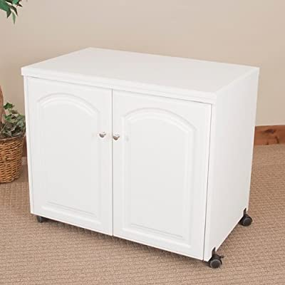 Model 7500 Space Saver Sewing Cabinet Pocket Doors, extra deep, extra leg room. Electric Lift.
