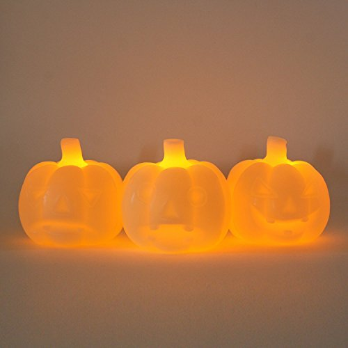 Set of 3 Halloween Mini Wax Ivory Carved Glowing Pumpkin Flameless LED Candles with Five Hour Auto Timer, 1 Warm White LED per Pumpkin, Batteries -