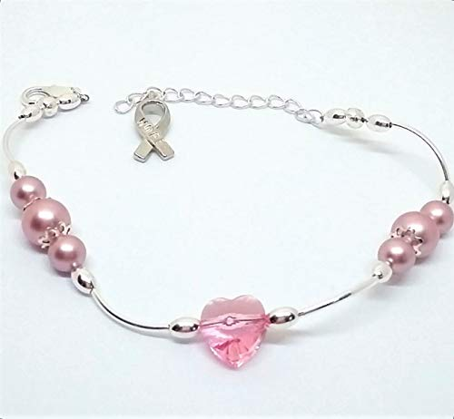 - Breast cancer awareness beaded bracelet with Swarovski pearls and heart with hope ribbon charm.