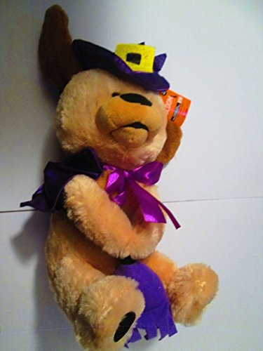 Animated plush dog with Purple witch hat, cape and broom and pumpkin 10