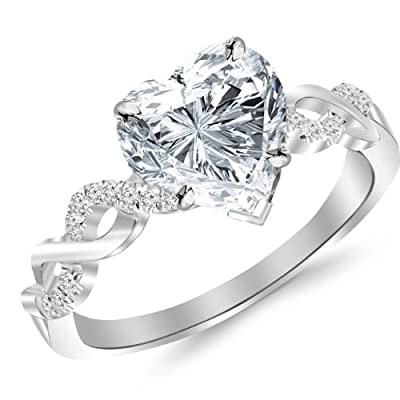 0.83 Carat Twisting Infinity Gold and Diamond Split Shank Pave Set Diamond Engagement Ring with a 0.7 Carat Heart Cut F-G Color SI1 Clarity Center Stone