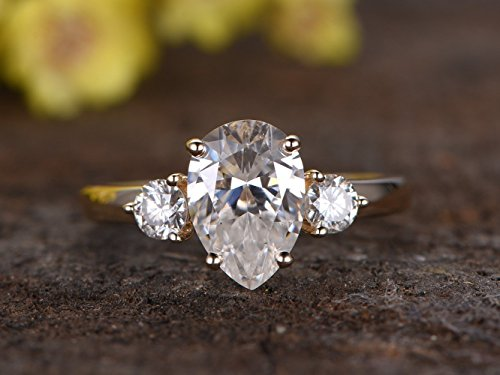 custom order: 3-carat pear-shaped Moissanite(approx 8x12mm), 0.4ct round moissanite (about 4-4.5mm) each side, size 7, 18k white Gold