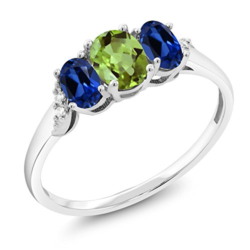 Gem Stone King 10K White Gold 1.33 Ct Green Peridot Blue Simulated Sapphire 3-Stone Ring With Accent Diamond (Size 5)