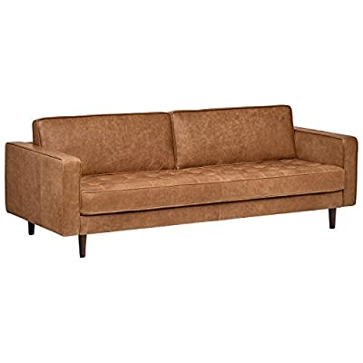 "Amazon Brand – Rivet Aiden Tufted Mid-Century Leather Bench Seat Sofa, Without Side Pillows, 86.6""W, Cognac - This sleek, Mid-century inspired leather sofa is designed to impress. A long fixed bench seat cushion, two back cushions, and tapered wood legs provide just the right mix of sophistication with a contemporary edge. 86.6""W x 36.2""D x 30.3""H Soft top-grain leather; solid hardwood frame; tapered wood legs - sofas-couches, living-room-furniture, living-room - 41Dr9DH5TSL. SS400  -"