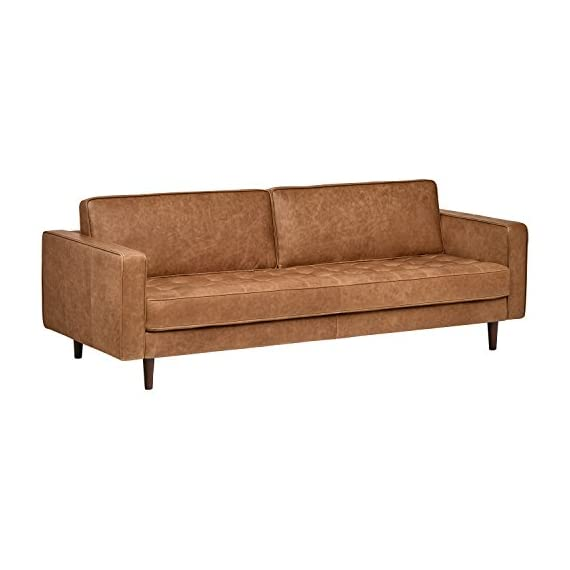 "Amazon Brand – Rivet Aiden Tufted Mid-Century Leather Bench Seat Sofa, Without Side Pillows, 86.6""W, Cognac - This sleek, Mid-century inspired leather sofa is designed to impress. A long fixed bench seat cushion, two back cushions, and tapered wood legs provide just the right mix of sophistication with a contemporary edge. 86.6""W x 36.2""D x 30.3""H Soft top-grain leather; solid hardwood frame; tapered wood legs - sofas-couches, living-room-furniture, living-room - 41Dr9DH5TSL. SS570  -"
