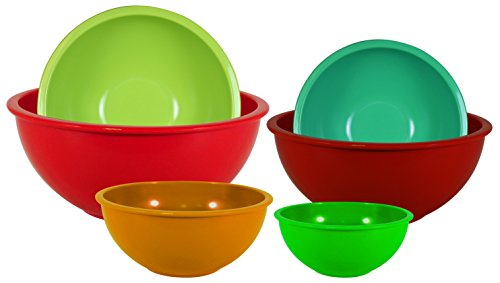A set of nested, plastic mixing bowls in different colors.