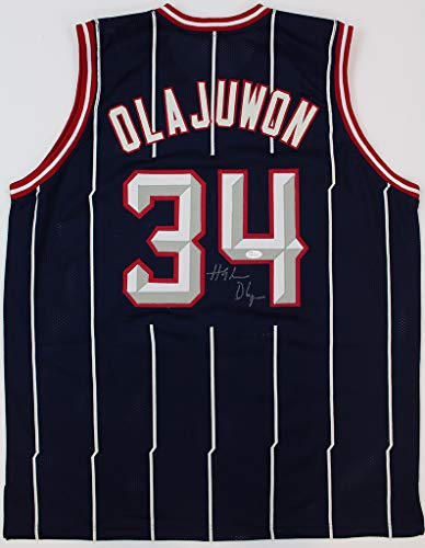 Olajuwon Signed Rockets Hakeem - Hakeem Olajuwon Autographed Blue & White Pinstriped Houston Rockets Jersey - Hand Signed By Hakeem Olajuwon and Certified Authentic by JSA - Includes Certificate of Authenticity
