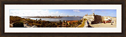 Morro Castle with city at the waterfront, Havana, Cuba by Panoramic Images Framed Art Print Wall Picture, Brown Gold Frame with Hanging Cleat, 60 x 18 - Pictures Havana Brown
