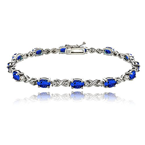 GemStar USA Sterling Silver Created Blue Sapphire 6x4mm Oval Infinity Bracelet with White Topaz Accents