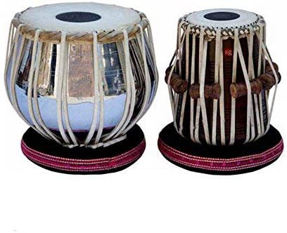 Hermoso juego de mesa de acero con instrumento musical indio ...