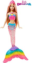 Make a real splash with the Barbie Rainbow Lights Mermaid doll! Dip this Barbie doll into water to see her mermaid tail glimmer with colorful lights inspired by a sparkling rainbow. It's a total wow moment! Simply press the button in Barbie d...