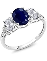 10K White Gold Diamond Accent Three-Stone Engagement Ring set with 2.84 Ct Oval Blue Sapphire White Topaz (Available in size 5, 6, 7, 8, 9)