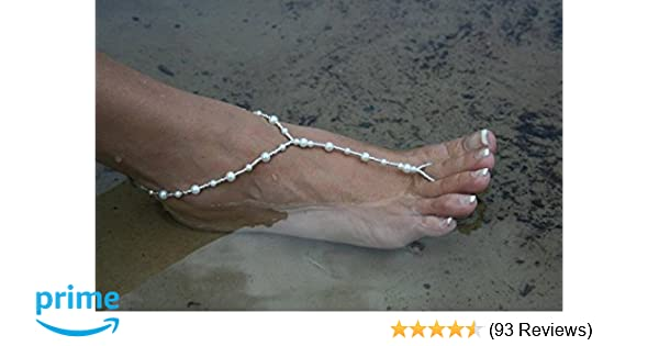 cdd880eaf07a Amazon.com  Ivory Barefoot Sandals Beach Wedding Beaded Anklet with  Starfish and Real Seashells - Set of 2  Shoes