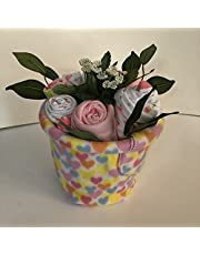 flower pots filled with baby clothing and accessories