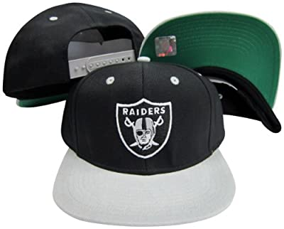 Oakland Raiders Logo Black / Silver Two Tone Plastic Snapback Adjustable Plastic Snap Back Hat / Cap from Reebok Licensed Division
