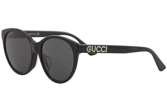 56305b7a75 Amazon.com  Gucci GG 0419SA 001 Black Plastic Round Sunglasses Grey ...
