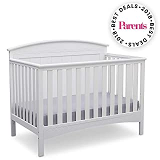 Perfect for traditional and modern nurseries alike, the Archer 4-in-1 Crib from Delta Children is remarkably versatile. You'll love the character it adds to your baby's space with its solid, gently arched headboard and airy slats. Designed to Delta C...