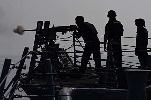 Home Comforts Sailors conduct a live-fire exercise aboard the guided-missile destroyer USS Ross (DDG 71) as part o by Home Comforts