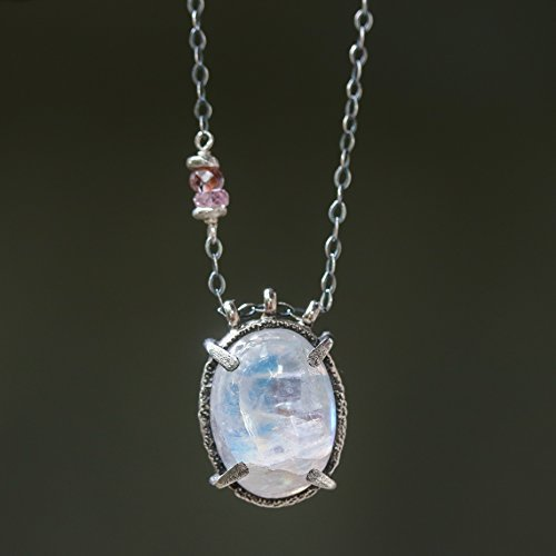 Cabochon oval moonstone pendant necklace in silver bezel and prongs setting with multi sapphire on the side and sterling silver chain