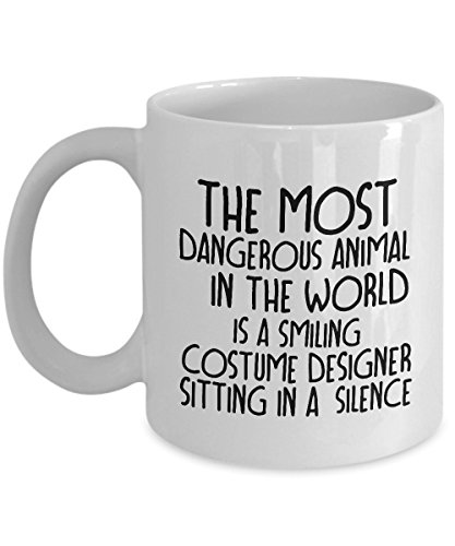 STHstore THE MOST DANGEROUS ANIMAL IN THE WORLD IS A SMILING COSTUME DESIGNER SITTING IN A. Funny For COSTUME DESIGNER Coffee Mugs - For Christmas, Retirement, Thank You, Happy Holiday Gift 11 OZ -