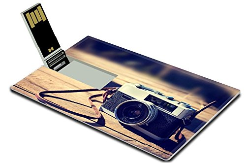 Luxlady 32GB USB Flash Drive 2.0 Memory Stick Credit Card Size Vintage camera on wooden background IMAGE 35799799 from Luxlady