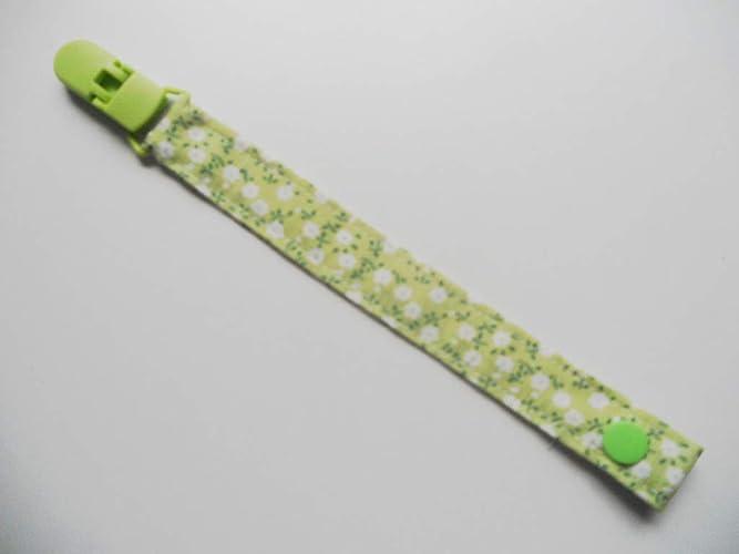 Chupetero de tela con clip Silvys, de color verde con flores blancas ...