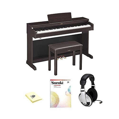 Yamaha YDP163R Traditional Console Digital Piano with Bench, Suzuki Piano School New International Edition Piano Book and CD Volume 1, Samson HP10 Stereo Headphones and a Zorro Sounds Polishing Cloth.