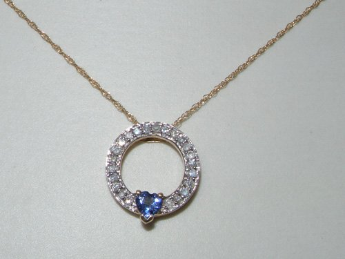 Collier en Or jaune 375/1000 sertie de Tanzanite Diamant
