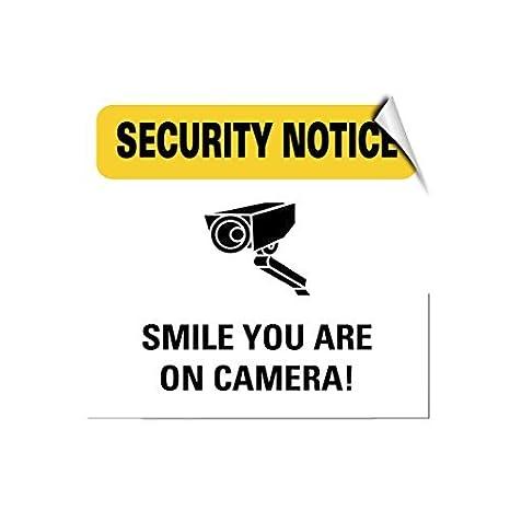 Aviso de seguridad sonrisa estás en cámara. Novedad de seguridad al aire libre Patio señal decorativa aluminio Metal Sign: Amazon.es: Jardín