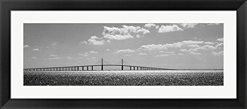 Bridge across a bay, Sunshine Skyway Bridge, Tampa Bay, Florida by Panoramic Images Framed Art Print Wall Picture, Black Flat Frame, 44 x 20 inches (Sunshine Skyway Bridge)