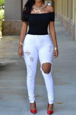 Frauen-weiße zerrissene dünne Jeans