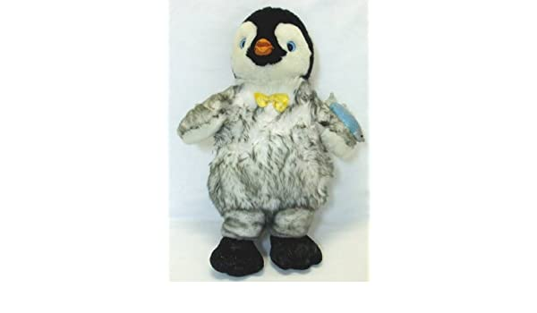 d8b650550ca Amazon.com  Build a Bear Stuffed Happy Feet Mumble with Glowing Heart Plush   Toys   Games