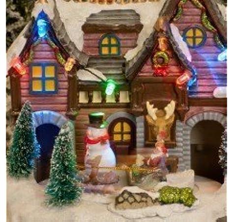 Navidad Musical Led Pueblo Escena Led Luces Precioso Muñeco De Nieve, Papá Noel & Reno Adornos Movibles Tren Que Círculos: Amazon.es: Hogar