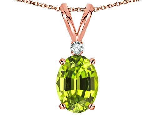 Star K Oval 7x5mm Genuine Peridot Classic Rabbit Ears Pendant Necklace 10 kt Rose Gold ()
