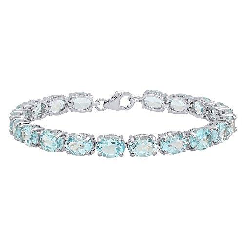 Sterling Silver 6X8 MM Each Oval Blue Topaz Ladies Tennis Bracelet