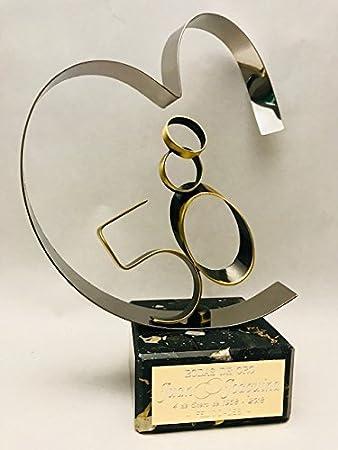 Material: Acero Inoxidable y Latón de alta calidad. Peana: Mármol. Medida ( altura ): 21cm,INCLUIDA