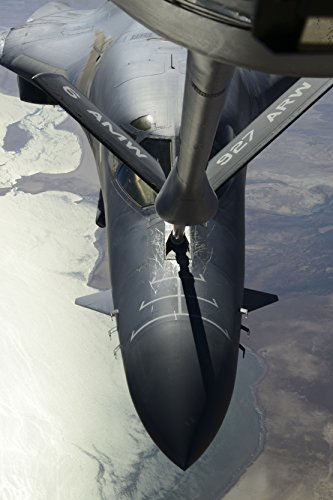 A KC-135 Stratotanker refuels a B-1B Lancer prior to air strikes over Syria Sept. 27, 2014. The B-1B