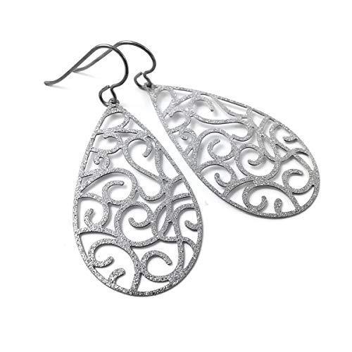 - Silver glitter teardrop dangle titanium earrings