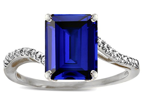Star K Big Stone Octagon Emerald Cut 10x8 Created Sapphire Bypass solitaire ring 14 kt White Gold Size 8